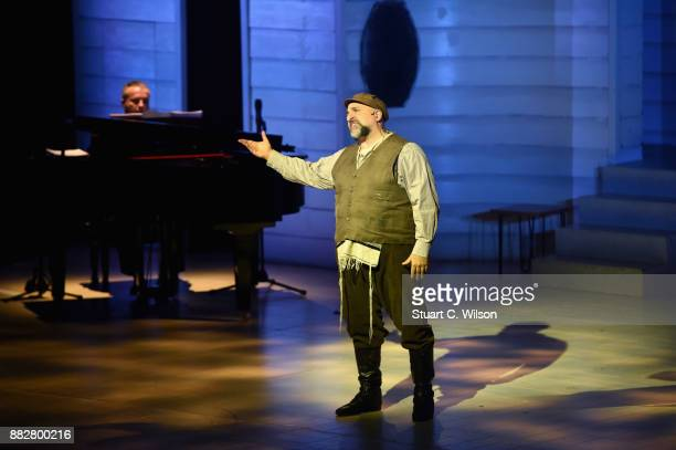Actor Omid Djalili performs on stage at the Chichester Theatre during Queen Elizabeth II's visit to West Sussex on November 30 2017 in Chichester...