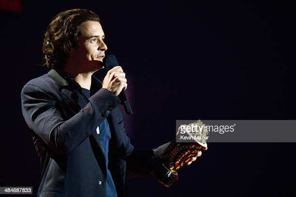 Actor Orlando Bloom accepts the Best Fight award for 'The Hobbit The Desolation of Smaug' onstage at the 2014 MTV Movie Awards at Nokia Theatre LA...