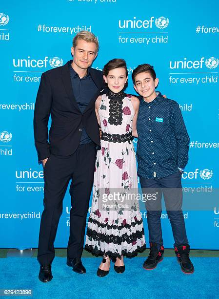Actor Orlando Bloom actress Millie Bobby Brown and Syrian refugee Mustafa Al Said attend UNICEF's 70th anniversary event at United Nations...