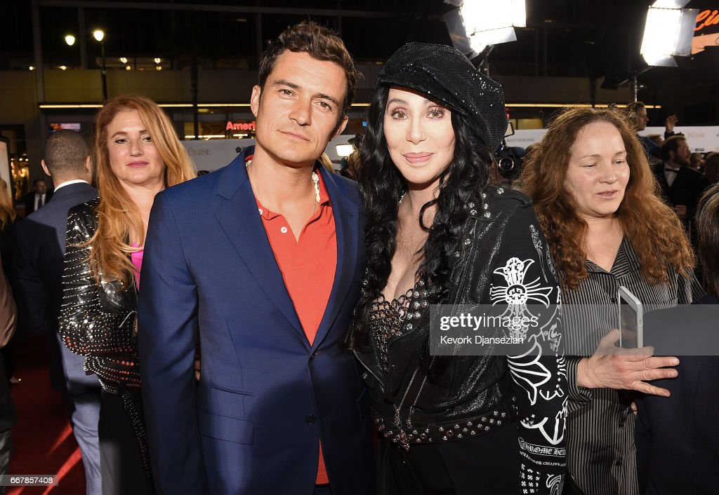 Actor Orlando Bloom (L) and actor/singer Cher attend the premiere of Open Road Films' 'The Promise' at TCL Chinese Theatre on April 12, 2017 in Hollywood, California.
