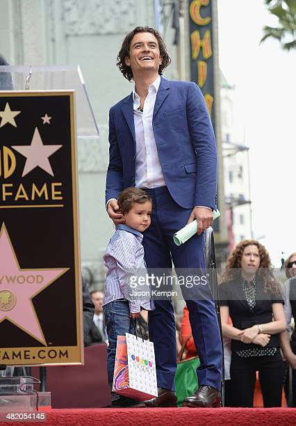 Actor Orlando Bloom and his son Flynn Bloom attend the Hollywood Walk of Fame celebration in honor of Orlando Bloom on April 2 2014 in Hollywood...