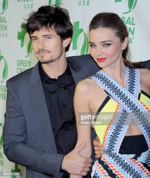 Actor Orlando Bloom and model Miranda Kerr arrive at Global Green USA's 10th Annual PreOscar party at Avalon on February 20 2013 in Hollywood...
