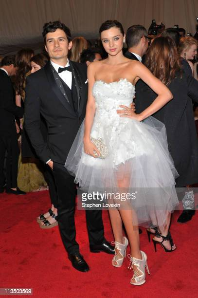 Actor Orlando Bloom and model Miranda Kerr attend the 'Alexander McQueen Savage Beauty' Costume Institute Gala at The Metropolitan Museum of Art on...