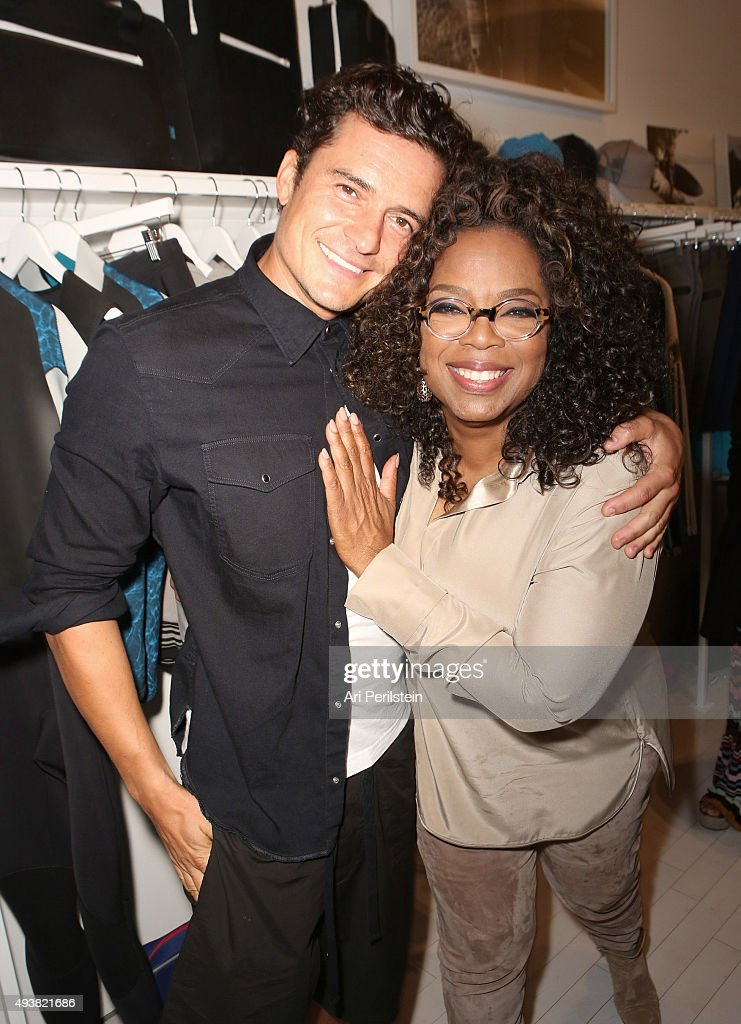 Actor Orlando Bloom (L) and Oprah Winfrey attend the launch of Laird Apparel by Laird Hamilton at Ron Robinson on October 22, 2015 in Santa Monica, California.