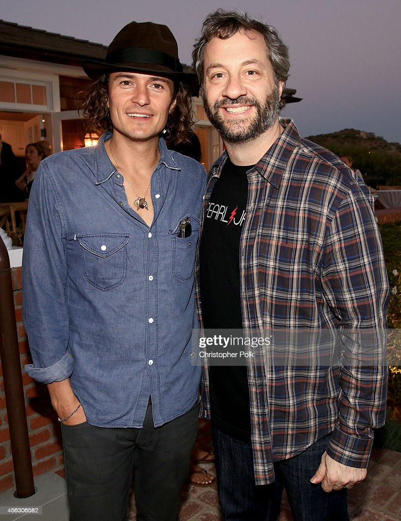 Actor Orlando Bloom and producer Judd Apatow attend Rock4EB, Malibu, with Jackson Browne & David Spade sponsored by Suja Juice & Sabra Hummus at Private Residence on September 28, 2014 in Malibu, California.