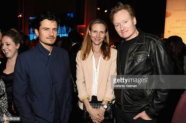 Actor Orlando Bloom Liza Powel O'Brien and tv host Conan O'Brien attend Coach's 3rd Annual Evening of Cocktails and Shopping to Benefit the...