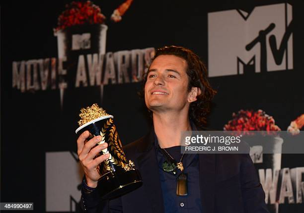 Actor Orlando Bloom poses in the press room of the 2014 MTV Movie Awards at the Nokia Theater in Los Angeles California on April 13 2014 AFP...