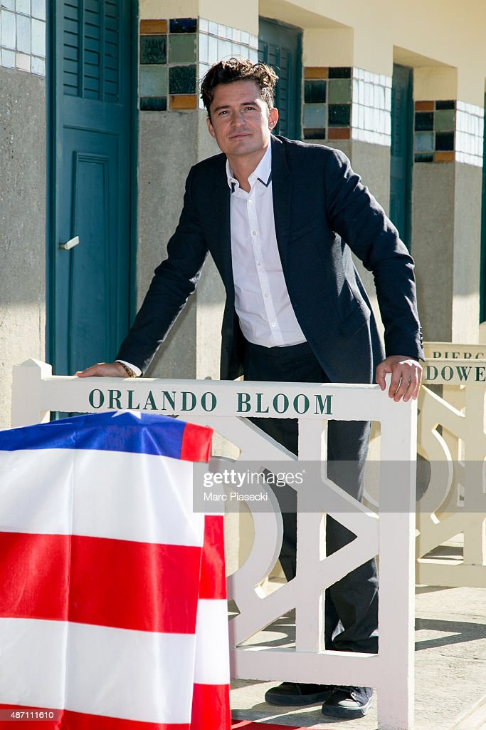 Actor Orlando Bloom poses next to the beach closet dedicated to him during the 41st Deauville American Film Festival on September 6, 2015 in Deauville, France.