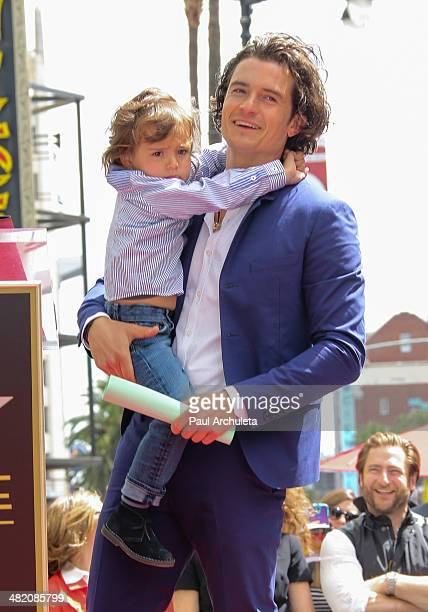 Actor Orlando Bloom with his son Flynn Bloom is honored with a Star on The Hollywood Walk Of Fame on April 2, 2014 in Hollywood, California.