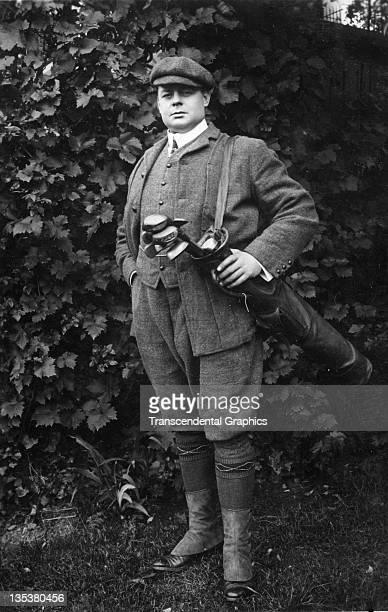 Actor Oscar Asche poses outdoors with his golf clubs for a publicity postcard circa 1910 in London, England.