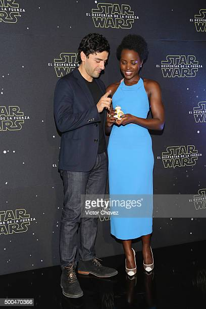 """Actor Oscar Isaac and actress Lupita Nyong'o attend the """"Star Wars: The Force Awakens"""" Mexico City photo call at St Regis Hotel on December 8, 2015..."""