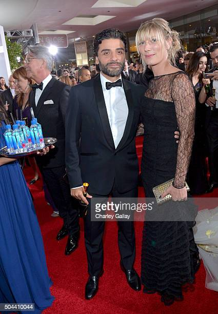 Actor Oscar Isaac and Elvira Lind attends the 73rd annual Golden Globe Awards sponsored by FIJI Water at The Beverly Hilton Hotel on January 10 2016...