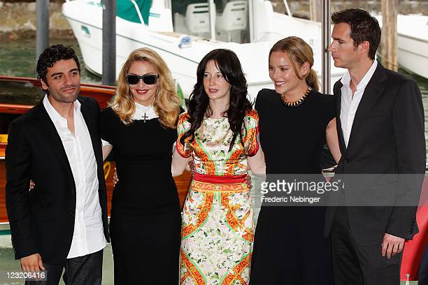 """Actor Oscar Isaac, Madonna and actors Andrea Riseborough, Abbie Cornish and James D'Arcy arrive for the""""W.E."""" photocall at the Palazzo Del Cinema..."""