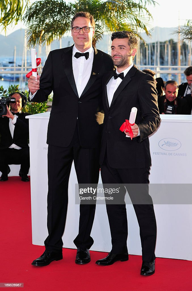 Actor Oscar Isaac (R) poses with the 'Grand Prix' award for 'Inside Llewyn Davis' at the Palme D'Or Winners Photocall during the 66th Annual Cannes Film Festival at the Palais des Festivals on May 26, 2013 in Cannes, France.