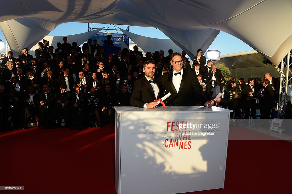 Actor Oscar Isaac (L) poses with the 'Grand Prix' award for 'Inside Llewyn Davis' at the Palme D'Or Winners Photocall during the 66th Annual Cannes Film Festival at the Palais des Festivals on May 26, 2013 in Cannes, France.