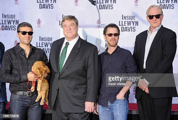 Actor Oscar Isaac Ulysses the cat actor John Goodman director/writer/producer Ethan Coen and executive music producer T Bone Burnett attend the John...