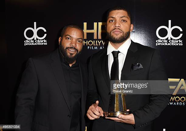 "Actor O'Shea Jackson Jr. , winner of the Hollywood Breakout Ensemble Award for ""Straight Outta Compton,"" poses with rapper Ice Cube in the press room..."