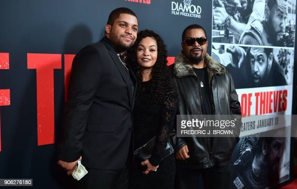 Actor O'Shea Jackson Jr with parents Kimberly Woodruff and O'Shea Ice Cube Jackson arrive for the premiere of the film Den of Thieves in Los Angeles...