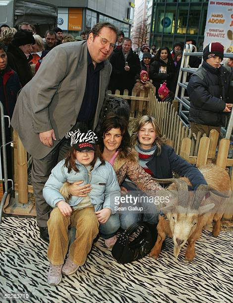 """Actor Ottfried Fischer arrives with his wife Renate and two daughters at the German premiere of """"Racing Stripes"""" on March 6, 2005 in Berlin, Germany."""
