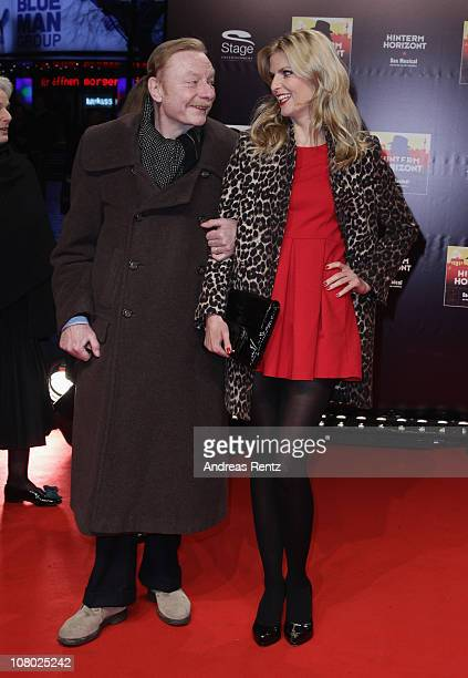 Actor Otto Sander and Tanja Buelter arrive for the 'Hinterm Horizont' musical premiere at Theater am Potsdamer Platz on January 13 2011 in Berlin...
