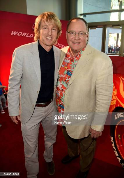 Actor Owen Wilson and John Lasseter Chief Creative Officer of Pixar attend the premiere of Disney and Pixar's 'Cars 3' at Anaheim Convention Center...