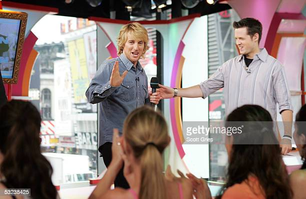 Actor Owen Wilson appears onstage with VJ Damien Fahey during MTV's Total Request Live at the MTV Times Square Studios July 14 2005 in New York City