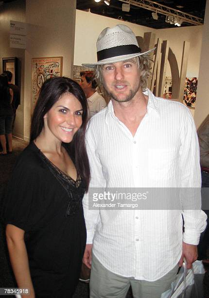 Actor Owen Wilson poses with a fan at the Miami Beach Convention Center during day five of Art Basel Miami Beach 2007 on December 9 2007 in Miami...