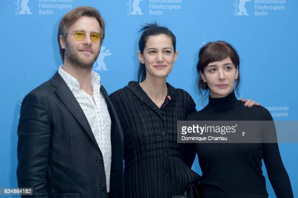Actor Ozgur Cevik director Ceylan Ozgun Ozcelik and actress Algi Eke attend the 'Inflame' photo call during the 67th Berlinale International Film...