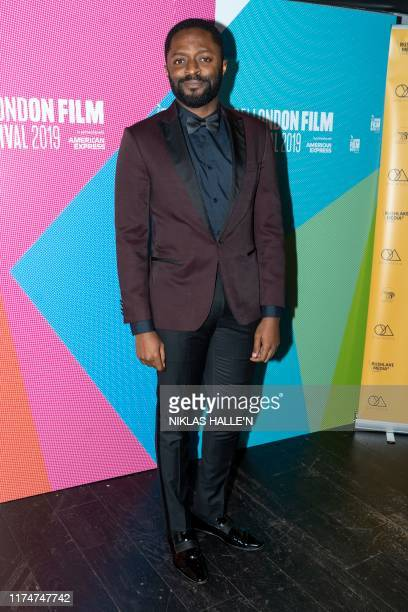 Actor Ozzy Agu poses as he arrives to attend the Walking With Shadows UK Premiere during the 63rd BFI London Film Festival at the Curzon Soho on...