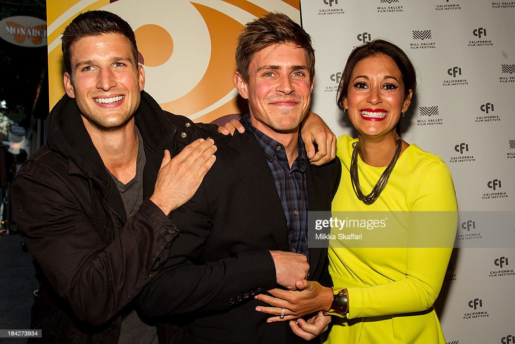 Actor Parker Young, director Chris Lowell and actress Angelique Cabral are arriving to the premiere of 'Beside Still Waters' on October 12, 2013 in Mill Valley, California.