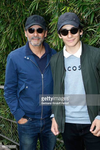 Actor Pascal Elbe and his son Leo attend the 2017 French Tennis Open Day Height at Roland Garros on June 4 2017 in Paris France