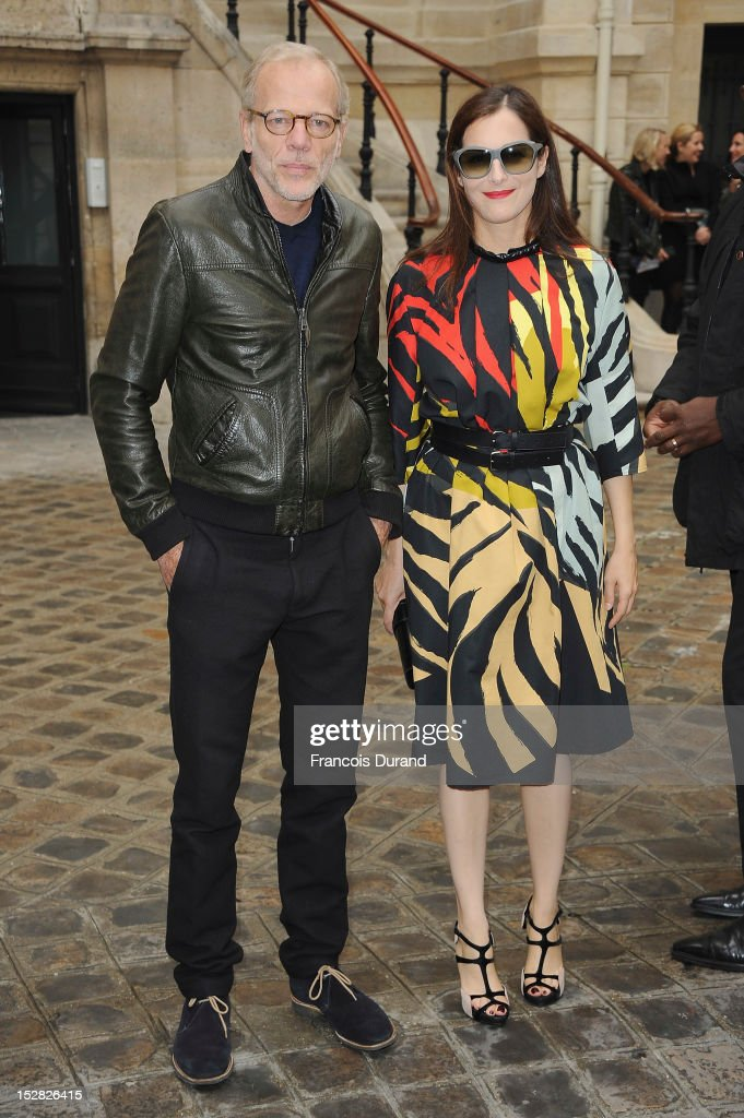Actor Pascal Greggory (L) and actress Amira Casar leave the Balmain Spring / Summer 2013 show as part of Paris Fashion Week at Grand Hotel Intercontinental on September 27, 2012 in Paris, France.