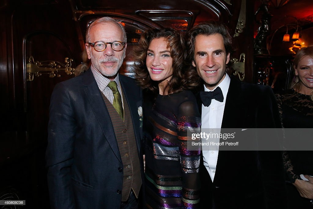 Actor Pascal Greggory, Tracey Amon and Pierre Pellegry attend the Dinner in honor of the Artist Adrian Ghenie organized by Thaddaeus Ropac at Maxim's on October 22, 2015 in Paris, France.