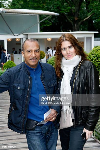 Actor Pascal Legitimus and his wife Adriana Santini attend Day Eleven of the 2016 French Tennis Open at Roland Garros on June 1 2016 in Paris France
