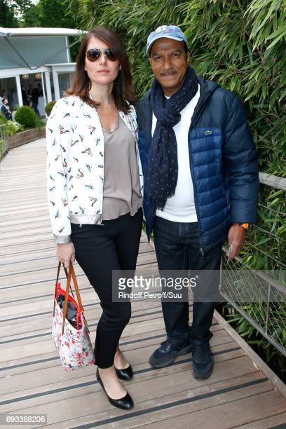 Actor Pascal Legitimus and his wife Adriana Santini attend the 2017 French Tennis Open Day Eleven at Roland Garros on June 7 2017 in Paris France