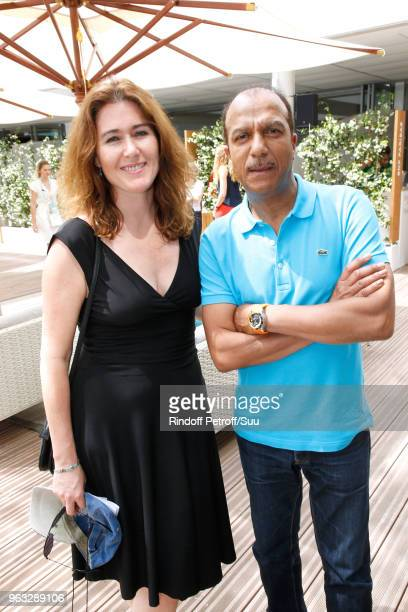 Actor Pascal Legitimus and his wife Adriana Santini attend the 2018 French Open Day Two at Roland Garros on May 28 2018 in Paris France
