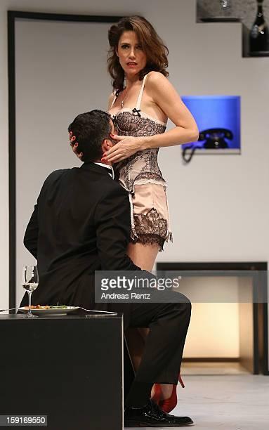 Actor Pasquale Aleardi and Julia Bremermann perform during the 'GeruechteGeruechte' photo rehearsal at Komoedie am Kurfuerstendamm Theater on January...