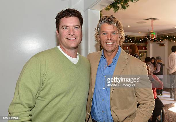 Actor Pat Finn and writer/director Robert Vince attend the 'Santa Paws 2 The Santa Pups' holiday party hosted by Disney Cheryl Ladd and Ali Landry at...