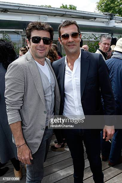 Actor Patrick Bruel and President of Lacoste Thierry Guibert attend the French Tennis Open 2015 at Roland Garros on May 30 2015 in Paris France