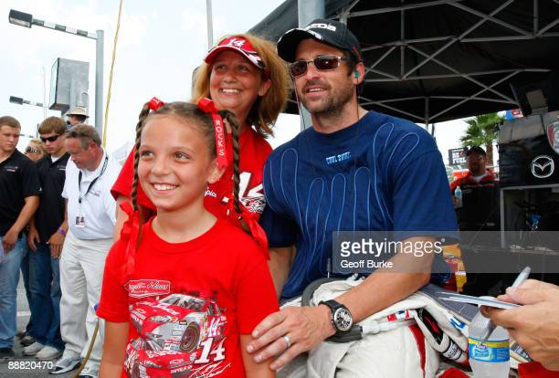 Actor Patrick Dempsey, driver of Dempsey Racing, poses for a picture with fans prior to the start of the Rolex Grand-Am Sports Car Series Brumos...