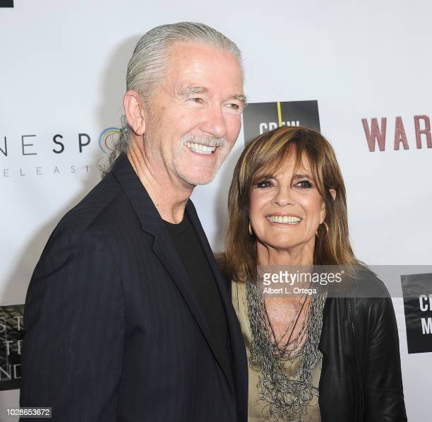 Actor Patrick Duffy and actress Linda Gray arrive for the Premiere Of Cinespots' Warning Shot held at The WGA Theater on September 6 2018 in Beverly...