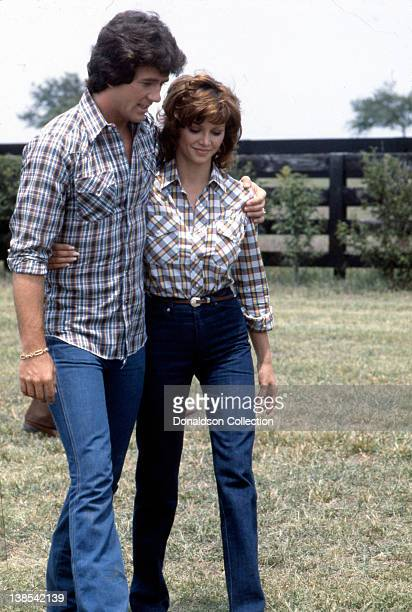 Actor Patrick Duffy and actress Victoria Principa in a quiet moment on the set of the TV show 'Dallas in circa 1982