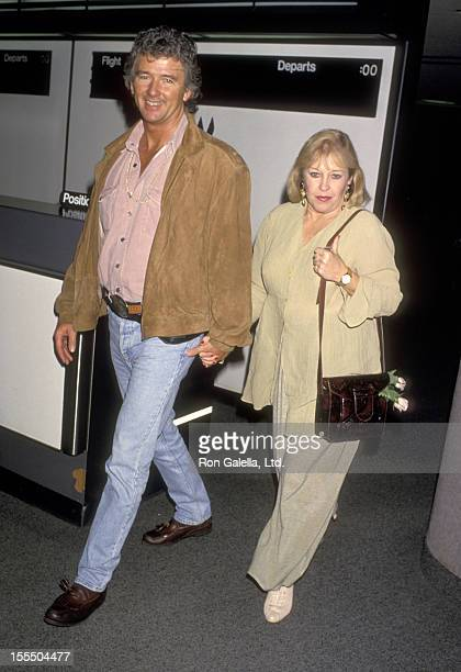 Actor Patrick Duffy and wife Carlyn Rosser on January 26 1994 arriving at the Los Angeles International Airport in Los Angeles California