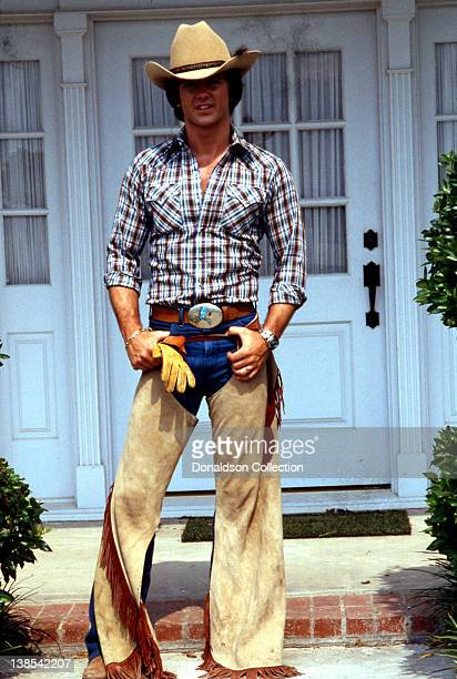 Actor Patrick Duffy poses for a portrait wearing a cowboy hat and chaps for a portrait session in circa 1980 in Los Angeles California
