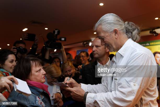 US actor Patrick Duffy signs autographs before QA as part of Series Mania Lille Hauts de France festival day 6 photocall on May 2 2018 in Lille France