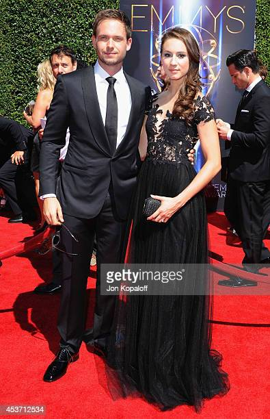 Actor Patrick J Adams and actress Troian Bellisario arrive at the 2014 Creative Arts Emmy Awards at Nokia Theatre LA Live on August 16 2014 in Los...