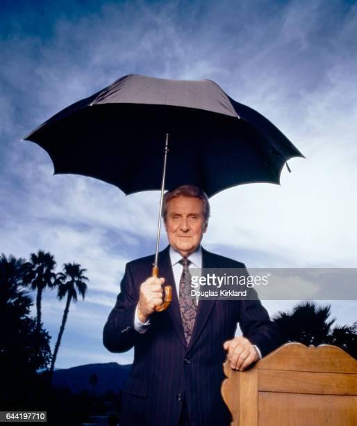 Actor Patrick Macnee Holding an Umbrella