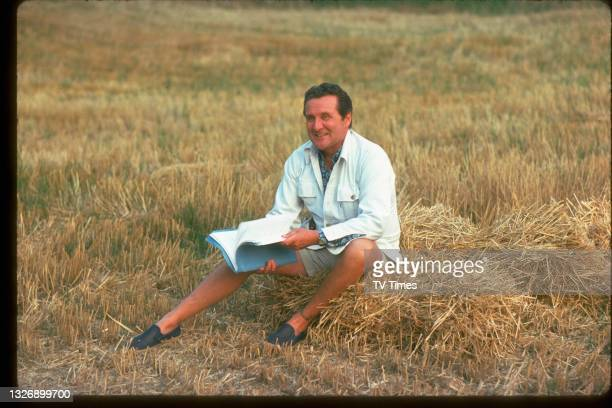 Actor Patrick Macnee reading a script on the set of action series The New Avengers, circa 1977.