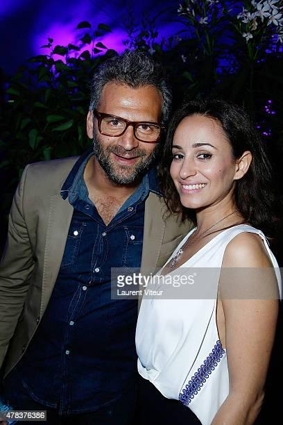 Actor Patrick Mimoun and Actresss Sanaa Alaoui attend the Hublot Blue Coktail at Mr Bleu at Palais de Tokyo on June 24 2015 in Paris France