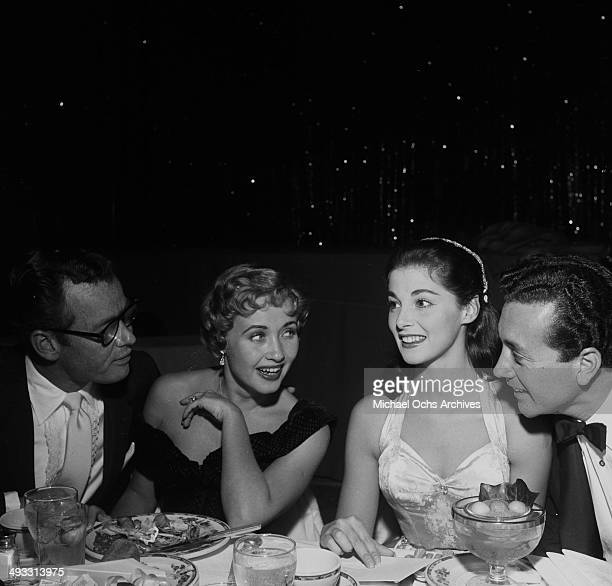 Actor Patrick Nerney actress Jane Powell Italian actress Pier Angeli and her husband entertainer Vic Damone at dinner at Cocoanut Grove in Los...